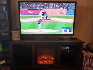 BEAUTIFUL TV STAND W. FIRE PLACE AND HEATER
