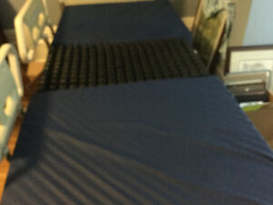 Hospital bed mattress with Royo insert