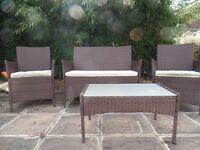 Four piece rattan garden furniture set