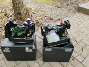 Two Antique Portable Singer Featherweight Sewing Machines