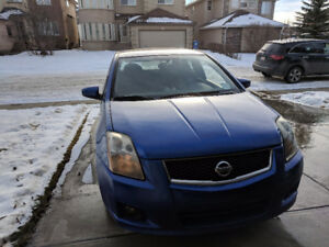 2009 Nissan Sentra 4 dr. I4 Man SE-R Spec-V Sedan - Damaged