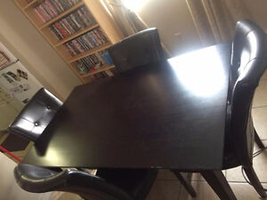 Dark table and leather chairs
