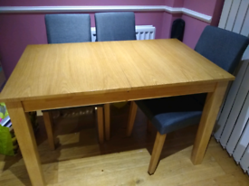 Extending wooden table and 6 chairs set
