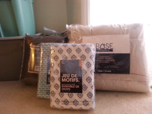 Brand new never used  sheet sets, comforters, etc.