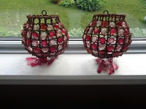 Decorative pink and burgundy tealight wall holders