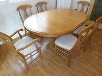Beautiful Solid Maple Dining Table with 6 chairs (Two with arm).