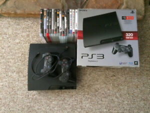 Sony PS3 Slim 320G, 2 controllers, and over 20 games