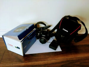 Canon PowerShot SX50 HS camera with a carry bag