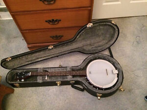 New banjo with case