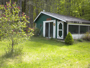 Beautiful 6 acre building lot for sale with winterized cabin