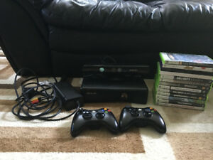 Xbox 360 Slim 4 GB with 2 controllers and 14 games