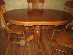 Oak Dining Room table with leaf and 4 Chairs