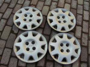 """Acura 15"""" 4 lug hubcaps in decent shape"""