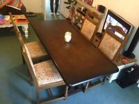 Hardwood dining table and four chairs