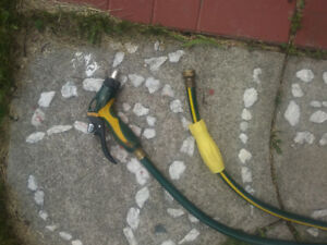 Excellent condition hose with MATCHING EXPENSIVE nozzil 100 feet