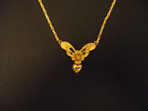 24k? stamped .9999 pure gold necklace with orchid pendant.