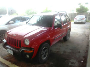 Red 2004 Jeep Liberty Columbia Edition
