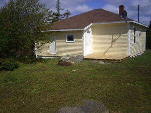 MAKE AN OFFER: WATERFRONT COTTAGE IN NEW PERLICAN, TRINITY BAY