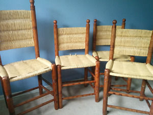 Four wood-frame and wicker dining-room chairs