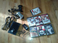 Playstation 2 Slim model with games