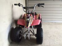 Childs 24 volt quad with charger and spare batteries