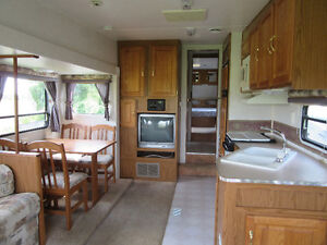READY TO GO! VERY SPACIOUS TRAILER! 31' LONG! **NEW PRICE**