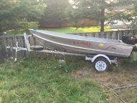 12 foot aluminum boat Lund, trailer and 9.9 Yamaha 2 stroke