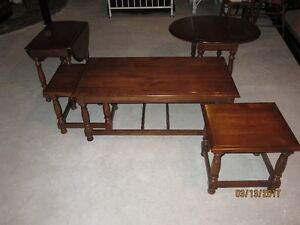 Coffee table with pull outs and side drop leaf tables