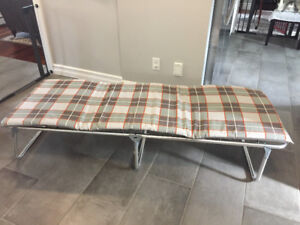 Folding cot with cushion