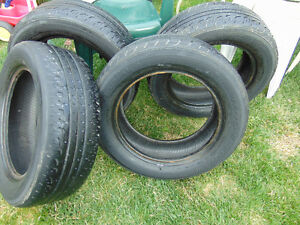 1 set of tires left by old owner of house toyo spectrum 225/60/