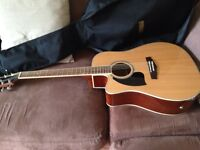 Left handed electro acoustic guitar