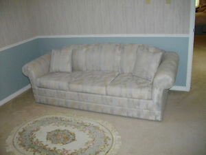 BEIGE UPHOLSTERED SOFA CONVERTIBLE TO DOUBLE BED