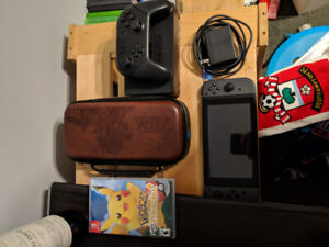 Nintendo Switch with Accessories and Let's Go Pikachu