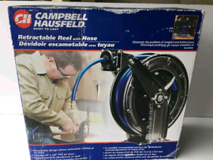 Air hose reel with 50' hose. (Auto retracting)