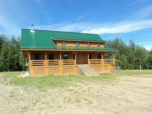 1/4 section with beautiful log home