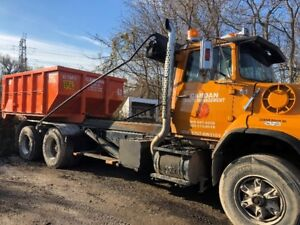 1990 Ford L9000 Roll Off Truck for sale