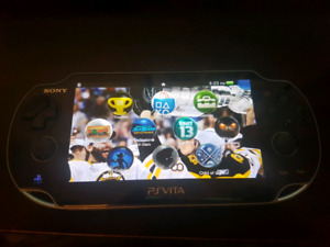 Ps Vita mint condition plus 7 games and 16 g memory