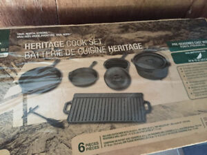 Cast iron cooking set still in wrapping $150.00