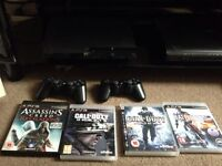 ps3 with 4 games and 2 pads and all the leads £80