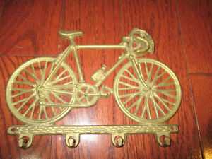Vintage brass key holder bike