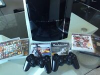 Playstation 3 with 2 controllers and 6 games