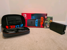 Nintendo Switch with Travel Case and Luigi's Mansion 3