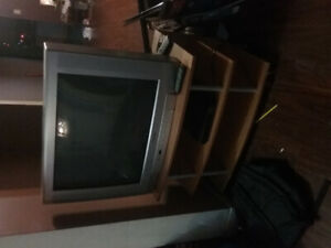 Tv and stand with dvd player/remote