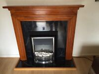 Solid oak wood surround with electric fire