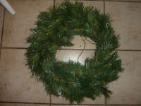 Various fake Christmas wreaths