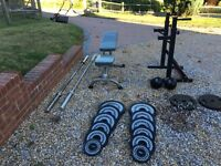 Weights Bench, Olympic Bar Bells, Squat Rack, 142.5 kg of Weights and Two Medicine Balls