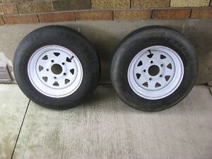 2 TRAILER TIRES AND RIMS