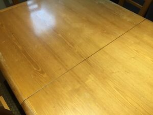 Solid wood table with 6 chairs and an extensions  West Island Greater Montréal image 2