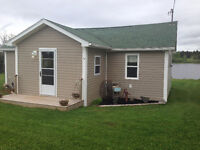 Cottage located on the Mill River minutes from Golf Course