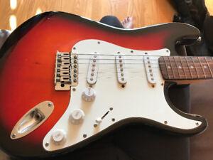 Guitare électrique + amplie